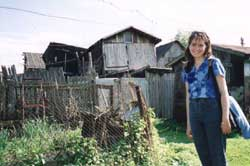 Krotovka village housing and Victoria, my translator that day.